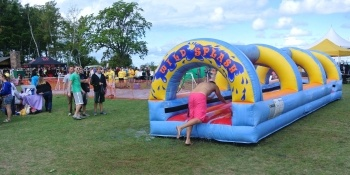 Students going into the blow up Wild Splash activity.