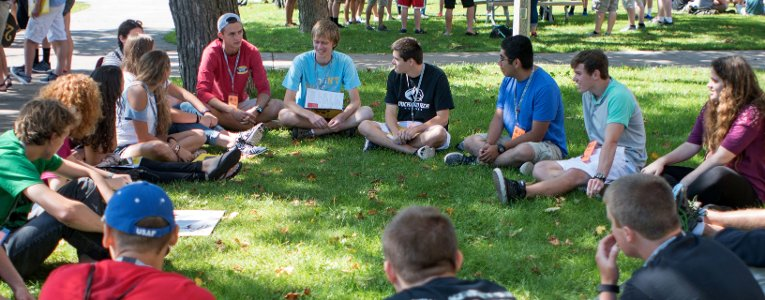 Students sitting in a circle on campus
