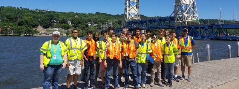 An SYP experience group stands in front of the Portage Lift Bridge.