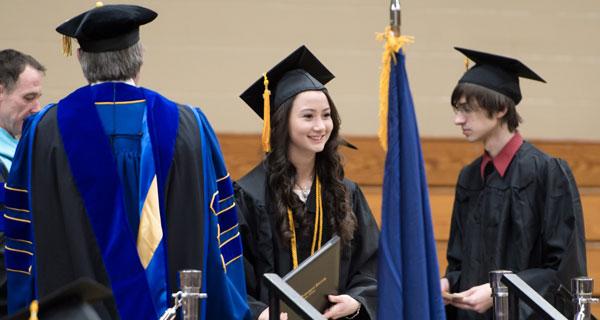 Student speaker Felicia Nip gets her degree.