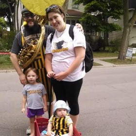 Young family at cherry parade