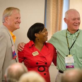 President Mroz and Alumni Association President Darnishia Slade greet new members of the Golden M Club.