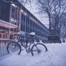 Even as the snow piles up, intrepid students bike to class.