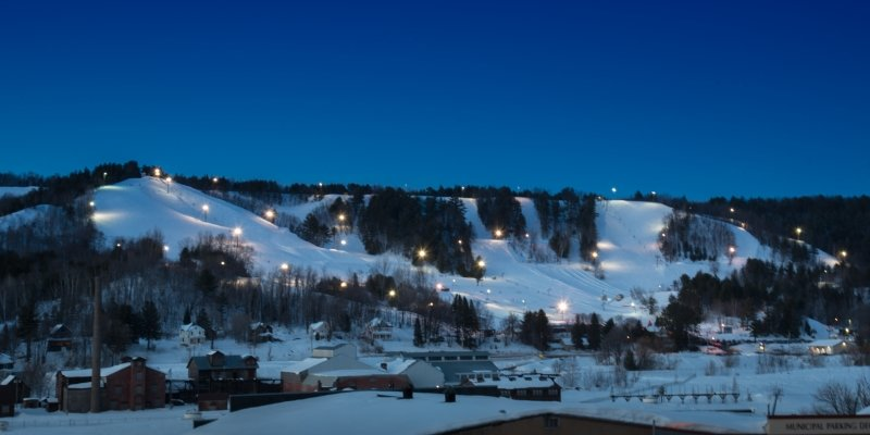 Mont Ripley Ski Area from across the waterway at night.