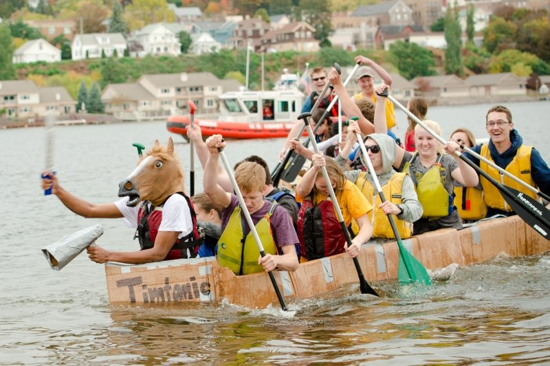 Students on a cardboard boat.