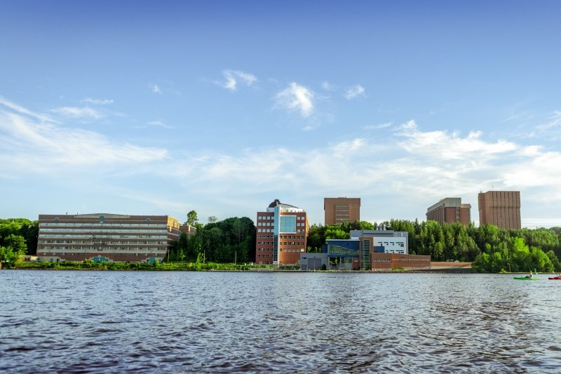 A view of campus from across the waterway.