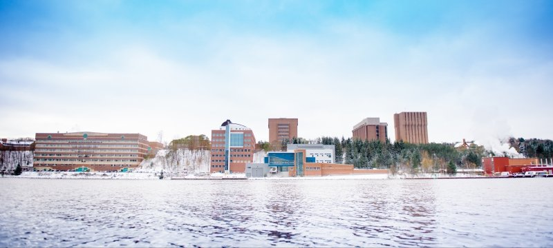 View of campus from across the waterway.