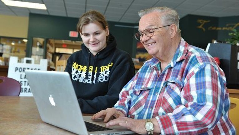 Michigan Tech students assist BASIC patrons on Saturday mornings at the Portage Lake District Library.