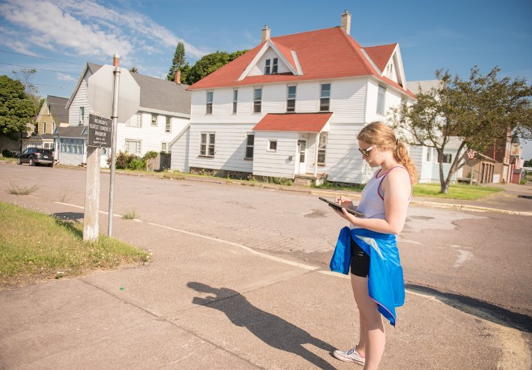 In this picture, a student participating in the GRACE project uses a GPS-enabled iPad to plots points around the communities of Calumet and Laurium.