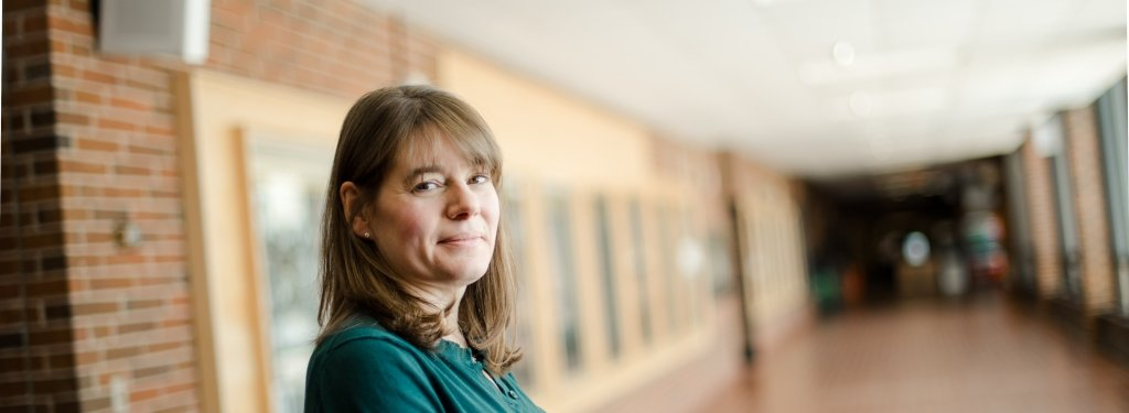 Kelly Kamm of kinesiology stands in an empty hallway