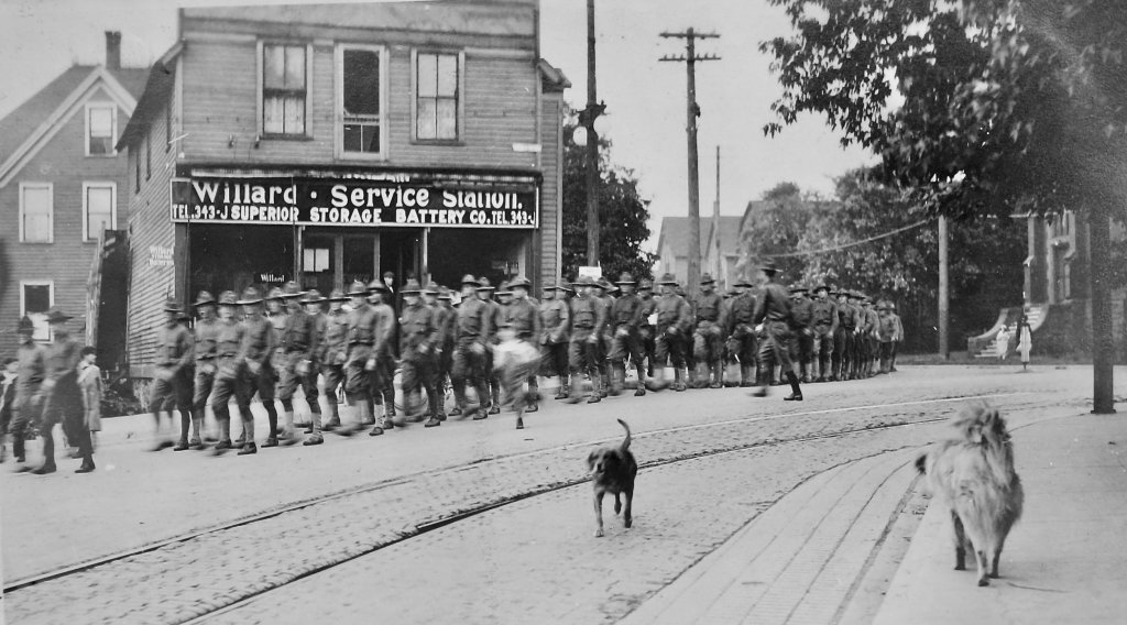 The first detachment to complete mining and military training at Michigan Tech turns       onto Shelden Avenue for their final march through downtown Houghton. (National Archives       photo)