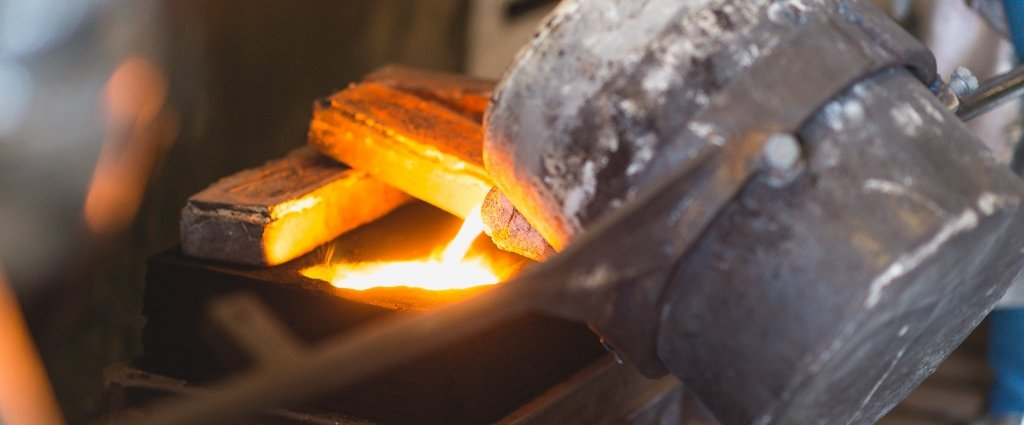 crucible in a foundry pouring molten metal