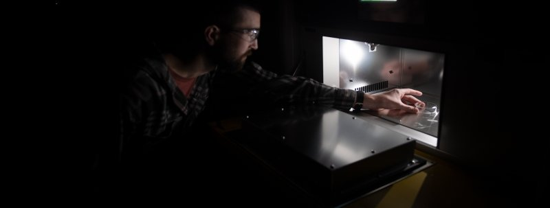 A student utilizing the sunlight simulator, the only lighting in the photo is provided       by the simulator.