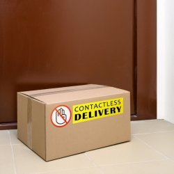 a box in front of a door that says touch-free delivery