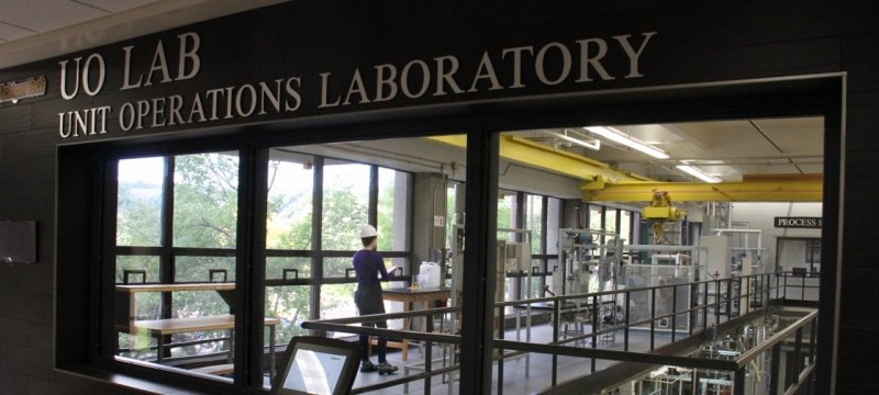 Window into large lab with sign that reads