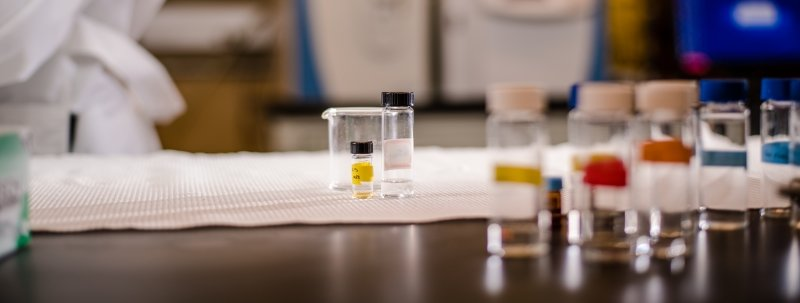 Vials on a table in a lab.