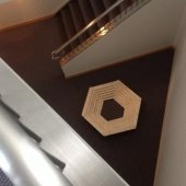 A wooden hexagon constructed by a student near the stairwell at the Rozsa Center for the Performing Arts. The hexagon starts smaller at the base and increases in size at the top.