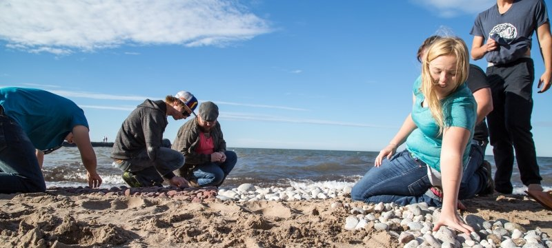 Students exploring the Lake Superior shoreline