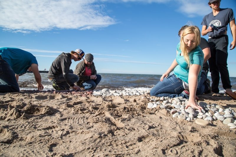 Students explore a Lake Superior beach