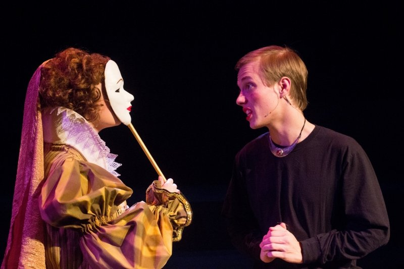 Student in costume with mask speaking with a sound technician
