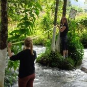 Lisa Gordillo and student Hannah Fisher work on an art installation in the San Juan River. Aguacatán, Guatemala.
