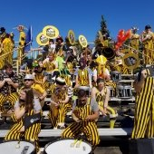 Tuba players and drummers on the Sherman Field bleachers
