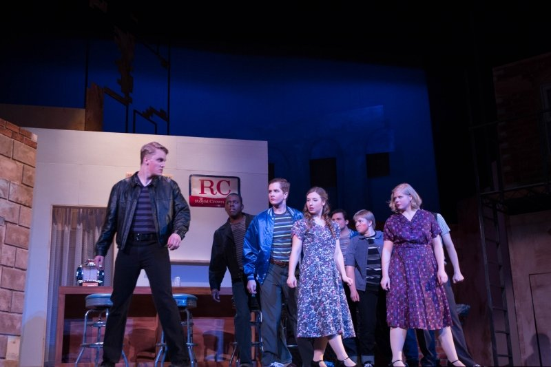 Students performing on stage the play West Side Story