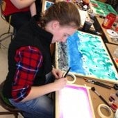 Student beginning a painting.