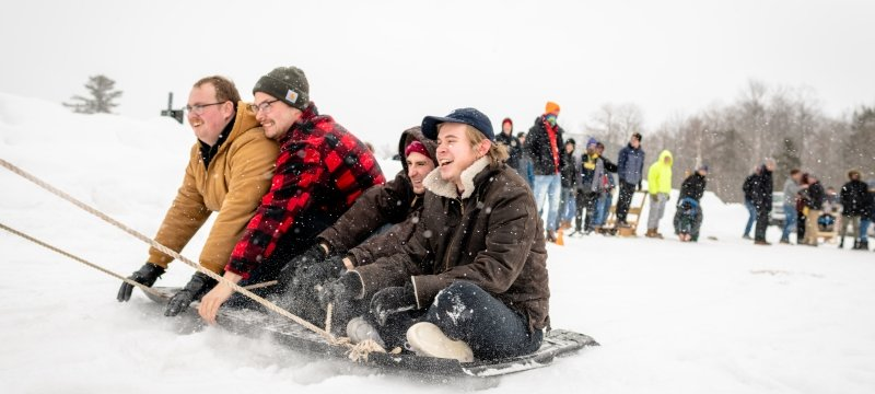 Students playing tug-o-war in the snow.