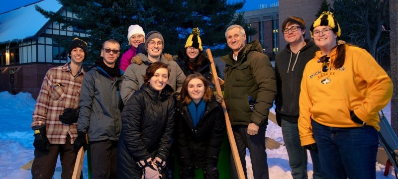 Students with President Koubek during Winter Carnival.